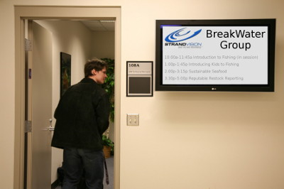 digital signage screen outside of meeting room